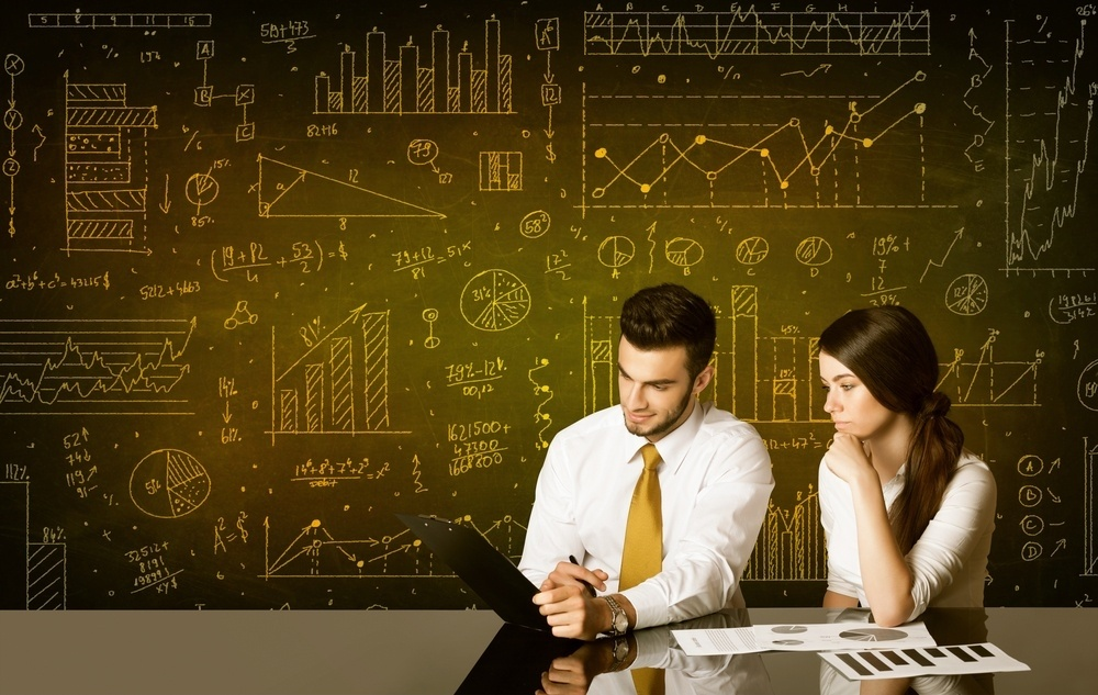 data-analysis-uncover-fraud-man-women-analyzing-data.jpeg