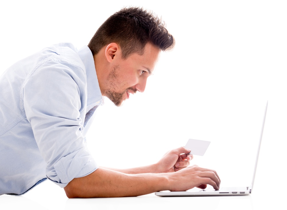 Man shopping online with a credit card - isolated over white