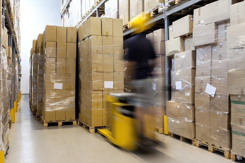 Fork-lift-with-operator-working-in-warehouse-408811-edited