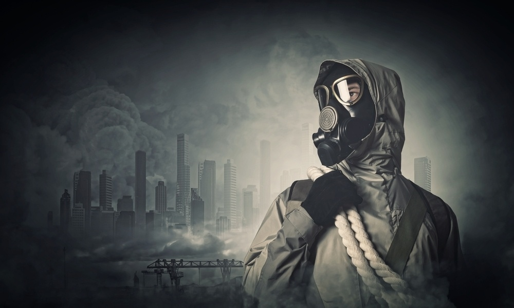 Man in gas mask against disaster background. Pollution concept-184480-edited